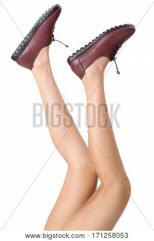 Woman beautiful long legs healthy skin stretching her legs pose and wearing vintage fashion leather shoes Isolated on white background.