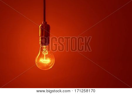 light bulb on red background close up