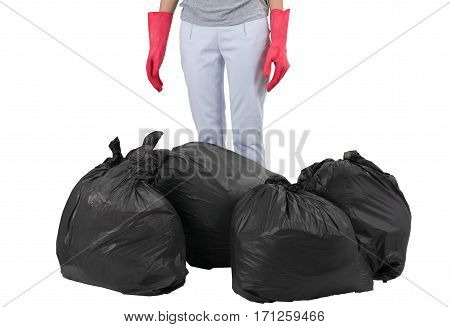 Asian housewife standing with garbage bags isolated on white background.