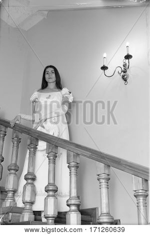 Vintage Portrait Of A Young Woman Walking Down The Stairs
