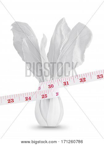 Measuring tape on white vegetable in lose weight concept Isolated on white background.