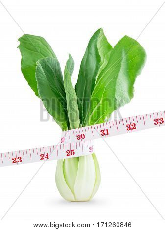 Measuring tape on Vegetable in lose weight concept Isolated on white background.