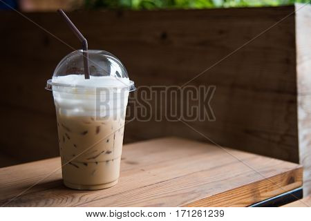 Ice Coffee In Plastic Glass
