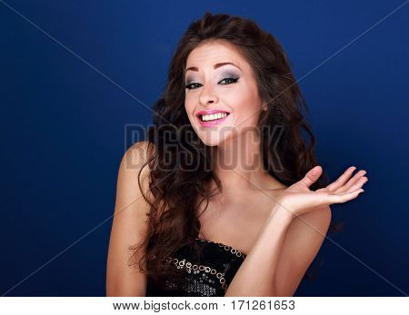 Excited Beautiful Makeup Woman Grimacing And Showing Oops Sign Her Hand On Blue Background. Closeup