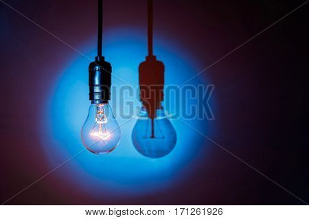 light bulb on blue background close up