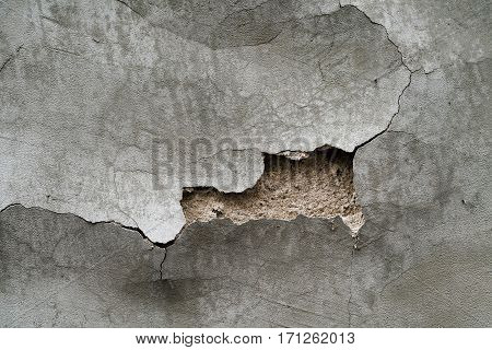 grey old House wall with plaster damage