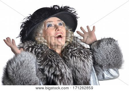 Senior woman in blouse affected on white background