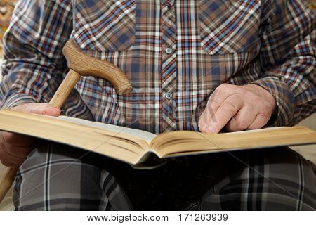 Old man reading a book. Senior people health care