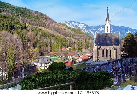 Parish Church of Saint Paul and cemetery in the alpine village Prein an der Rax. Lower Austria poster
