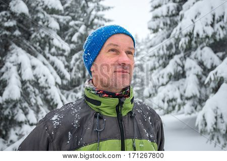 Portrait Of Happy Man Traveler In The Winter Mountains