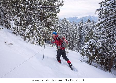 Traveler Man Goes To Snowshoeing Uphill