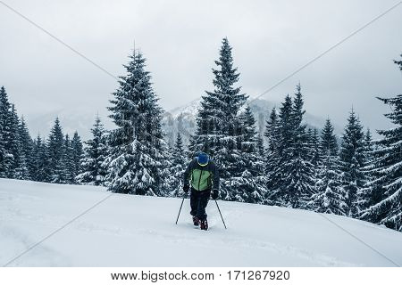 Traveler Man Climbs Up The Slope In Deep Snow