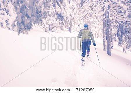 Man Running Snowshoeing In Deep Snow