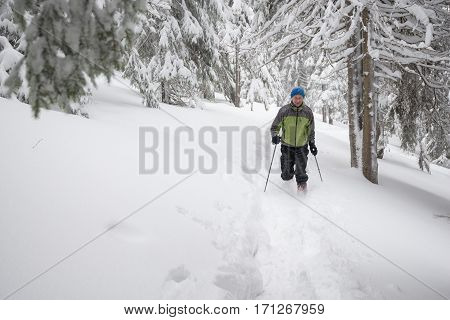 Happy Man Running On A Track In Deep Snow