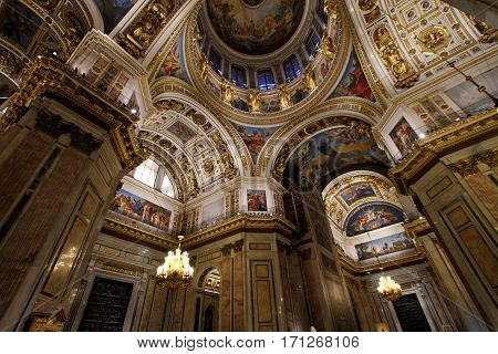 SAINT-PETERSBURG RUSSIA - JANUARY 03 2017: The painting on the dome and walls of St. Isaac's Cathedral in St. Petersburg Russia. The interior decoration.