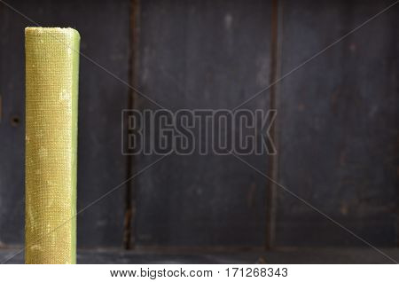 Green antique book spine on old wooden bookshelf background
