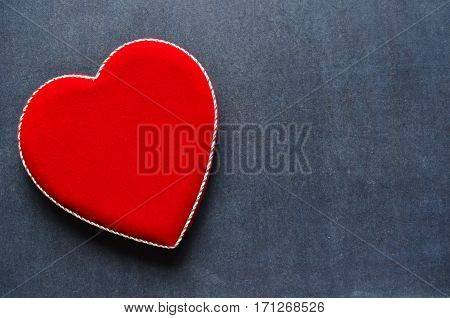 Velvet heart shaped box on a black chalkboard background