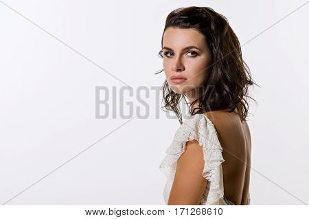Beautiful woman. The brunette with brown eyes. Photographed in studio on a white background.