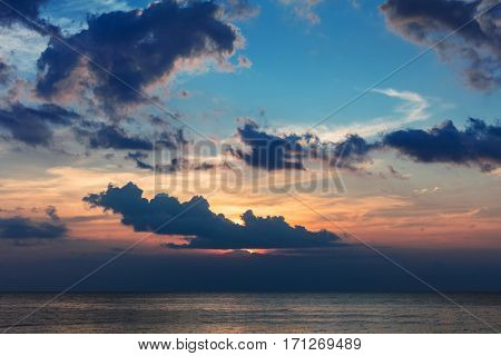 colorful cloudy sunset over the ocean