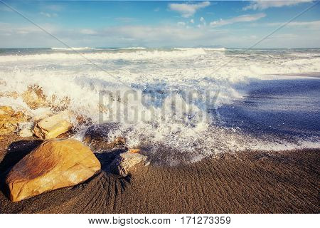 waves on the sea landscape on a background of blue sky. Location cape San Vito. Sicilia, Italy, Europe. Mediterranean and Tyrrhenian sea.