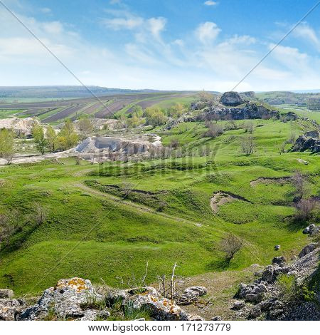 Deposits of limestone quarry green hills and rural landscape
