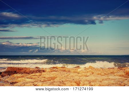 waves on the sea landscape on a background of blue sky. Location cape San Vito. Sicilia, Italy, Europe. Mediterranean and Tyrrhenian sea