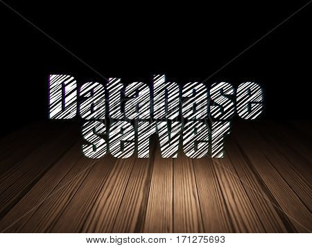 Programming concept: Glowing text Database Server in grunge dark room with Wooden Floor, black background