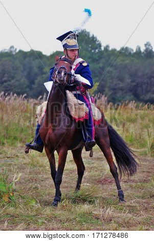 BORODINO MOSCOW REGION - SEPTEMBER 04 2016: Reenactor  rides a horse, he is  dressed as Napoleonic war soldiers at Borodino battle historical reenactment in Russia. Color photo.