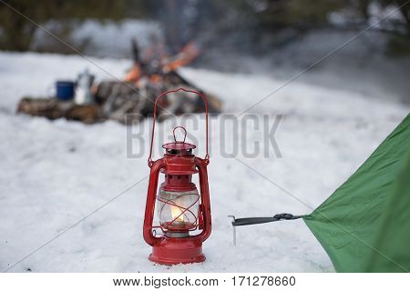 camping in the wood in the winter in a mountain tent