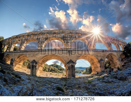Pont du Gard against sunset is an old Roman aqueduct in Provence France