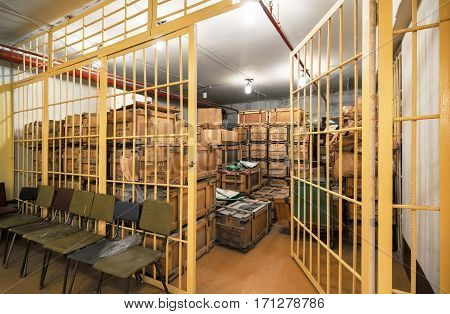 Open the door warehouse with wooden boxes with equipment to take refuge in the bomb shelter