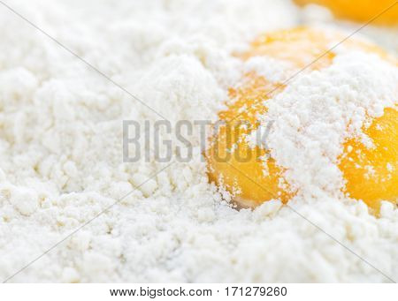 close up of egg yolk white background made from flour to ad copy space for menu notices or index.