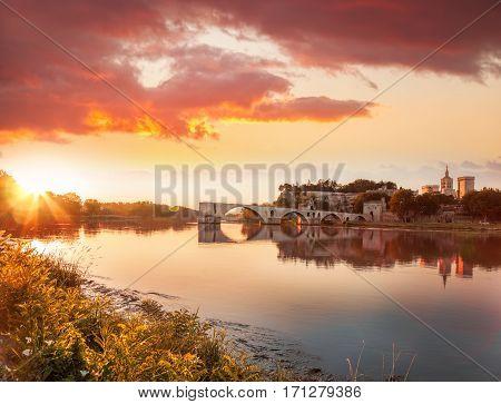 Avignon Old Bridge Against Colorful Sunset In Provence, France