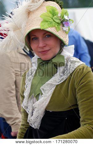 BORODINO MOSCOW REGION - SEPTEMBER 04 2016: Reenactor woman at Borodino battle historical reenactment in Russia. Color photo.