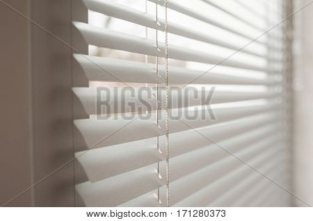 white metal blinds in the office at day