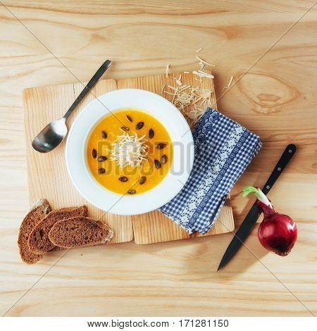Pumpkin soup in white bowl, dietary vegetable.