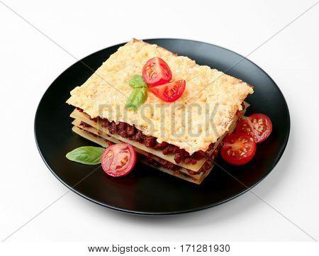 Tasty homemade Italian lasagna, white background