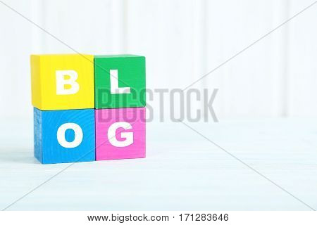 Colorful Wooden Toy Cubes On A Blue Wooden Background