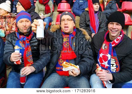 MOSCOW - OCT 23, 2016: Fans of CSKA team at football match Lokomotiv - CSKA on Locomotive stadium