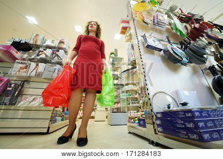 MOSCOW - OCT 14, 2016: Woman (with model release) with bags in Goods for Home shop