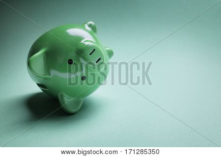 Piggy bank fallen over with financial money problems and copy space