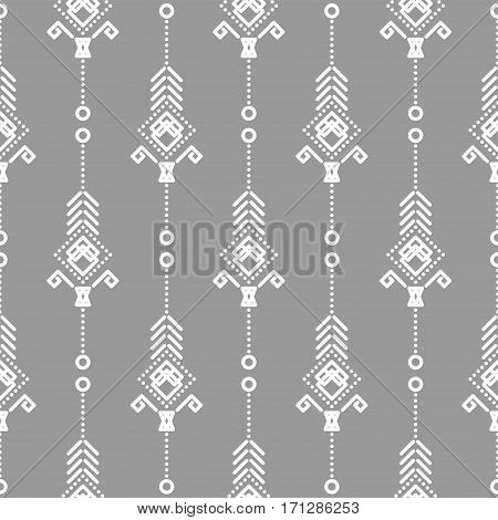 Bohemian seamless vector pattern. White on gray tileable navajo background.