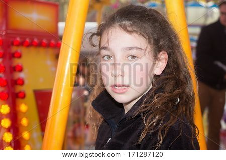 Girl Curly Child In An Amusement Park To Play