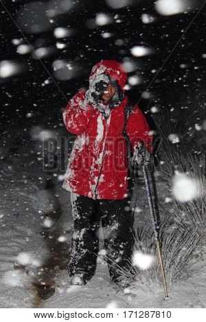 Female hiking in the UK in a blizzard