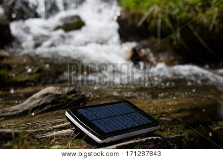 Solar water heaters on green meadow in the mountains