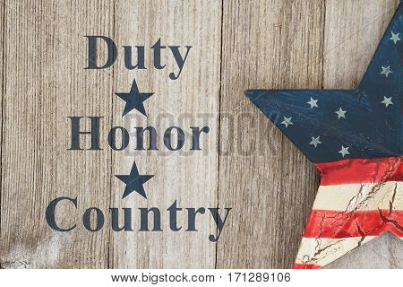 Duty Honor and Country message USA patriotic old flag on a star a weathered wood background with text Duty Honor Country