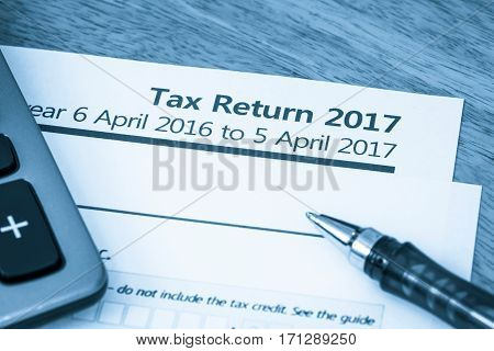 Cool toned image of UK income tax return form for 2017