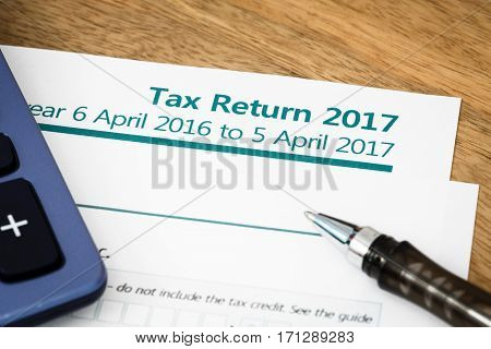 Close up of UK Income tax return form with tax period for 2017