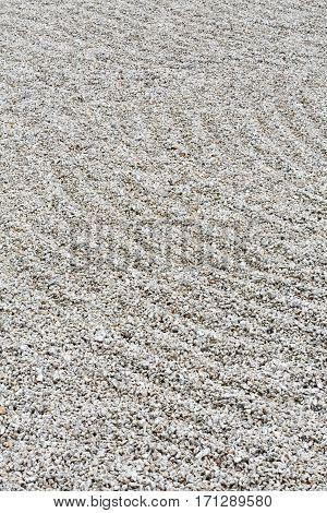 Circular raked gravel pattern in a zen garden