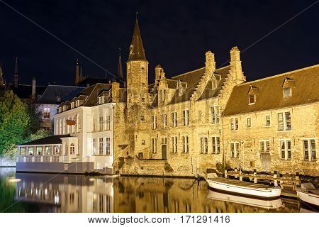 Night view from the promenade Rozenhoedkaai along the canal in the center of medieval city Bruges, Belgium.
